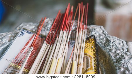 Smoldering Incense In A Buddhist Temple Close-up. Excursions On Buddhist Temples And Pagodas Of Thai