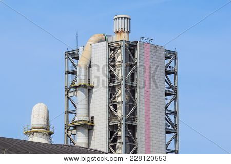 Refinery Tower In Petrochemical Industrial Plant With Cloudy Sky .