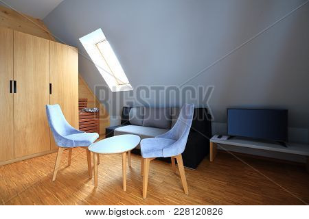 Coffee Table With Two Gray Chairs On Wooden Floor. Modern Wooden Interior.