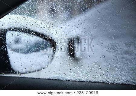 Water Drops On Car Window Close-up. Dangerous Driving In Bad Weather Conditions. Rainy Weather Outsi