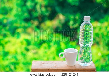 Bottle Water Made To Plastic On Tree Blurry Background.using Wallpaper For Package Or Product, Refre