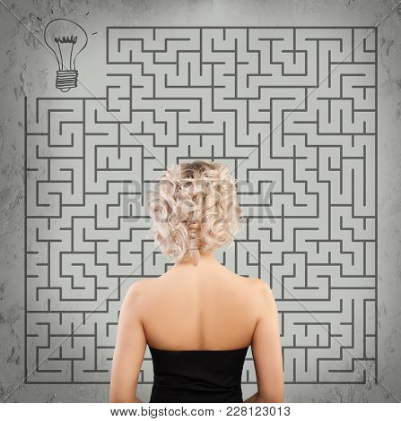 Girl On Labyrinth Background. Start Up, Idea, Business Planning And Strategy Concept