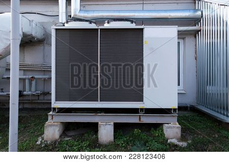 Gray Cooling Unit For Central Ventilation System With Big Ventilation Unit Standing Outdoor On The G