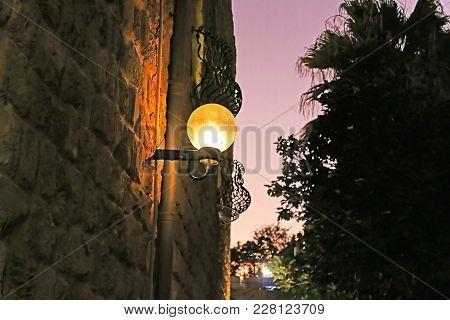Lamp on street of stone old city Jaffa in Tel Aviv, Israel poster