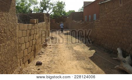 Gourcy/ Burkina Faso  - 7/20/2009: Typical Traditional Mud Built Village Lane In The Sahel Region Of
