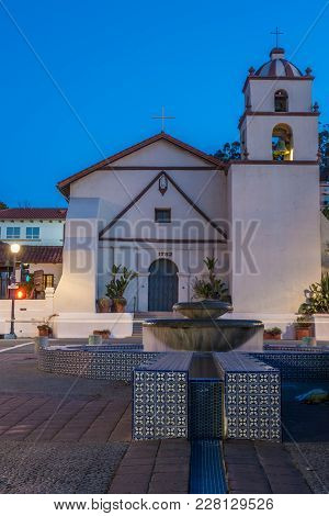 San Buenaventura Mission On Main Street In City Of Ventura Under Blue Sky Behind Water Fountain And