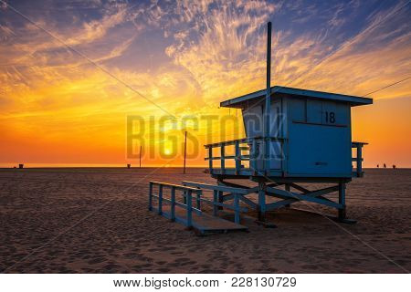 Sunset Over Santa Monica Beach With Lifeguard Observation Tower In The Foreground In Los Angeles, Ca