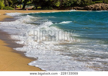 Sea Waves Run On The Sandy Beach, Waves Foam , Small Storm, Halkidiki, Greece.