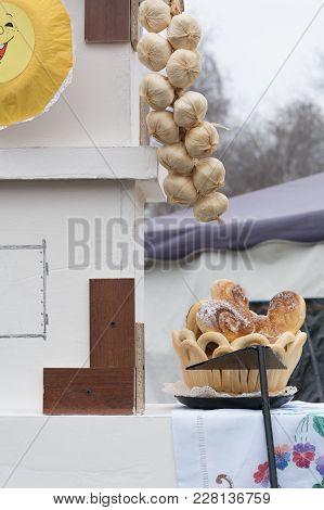 Buns In A Wicker Basket On The Street