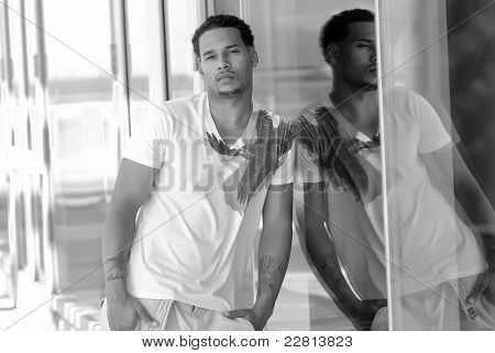 portrait of sexy young male in city