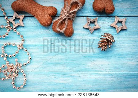 Christmas Doggy Cookies On Blue Wooden Background