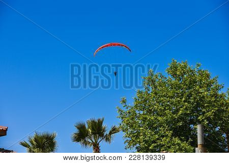 Oludeniz, Turkey - May 07, 2017:  Paragliding Over The Sea And Blue Lagoon. Tourist Can Fly Together
