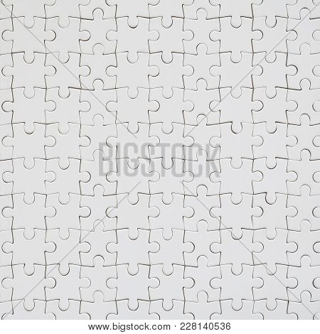 Close Up Texture Of A White Jigsaw Puzzle In Assembled Condition. Top View. Many Components Of A Lar