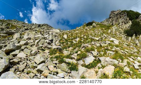Difficult Hiking Trail Going Uphill Through The Rocks On Steep Mountain Slope In Pirin National Park