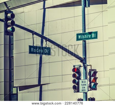 Rodeo Drive And Whilshire Boulevard Signs In Beverly Hills, California