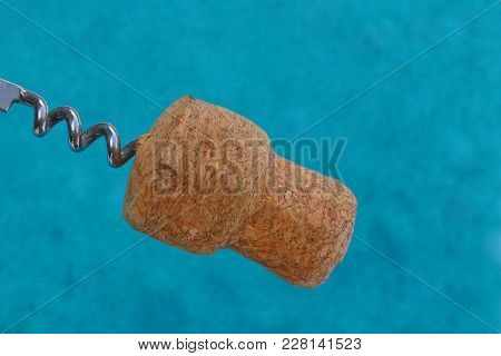 Brown Cork On A Steel Corkscrew On A Blue Background