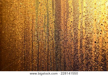 The Texture Of Misted Glass With A Lot Of Drops And Drips Of Condensation Against The Sunlight At Da