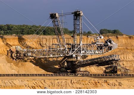 Huge Bucket Wheel Excavator Mining For Brown Coal In An Open Pit Mine.