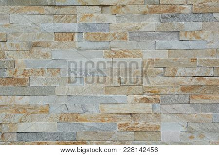 Stone Wall With Smooth Natural Stones Form A Pattern - Background