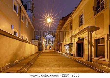 Old Medieval City Gates In The Night Illumination. Vilnius. Latvia.