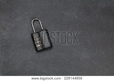 Combination Lock On The Brown Wooden Table Background