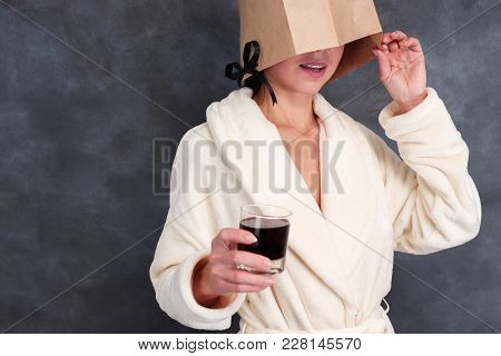Unknown Lady Wearing Bathrobe With Closed Face Drinking Alcohol Cocktail. Incognito, Hangover,  Dang
