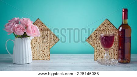 Passover Holiday Celebration Concept With Wine, Matzo And Flowers.