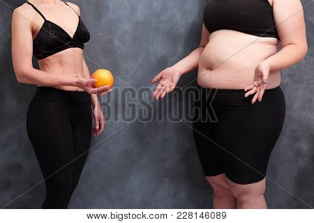 Fit Woman Offering Grapefruit To Overweight Lady. Extreme Diet, Starving, Harm, Healthcare, Weight L