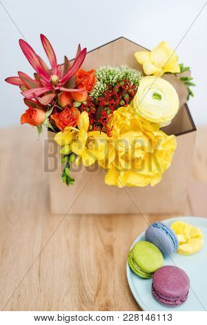 Giftbox With Flowers And Sweets. Macaroons And Spring Bouquet In Wooden Box