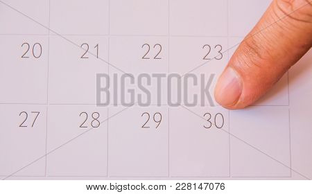 Finger Push On Calendar Page For Remind And Marked Important Events Day,finger Pin In A Calender On