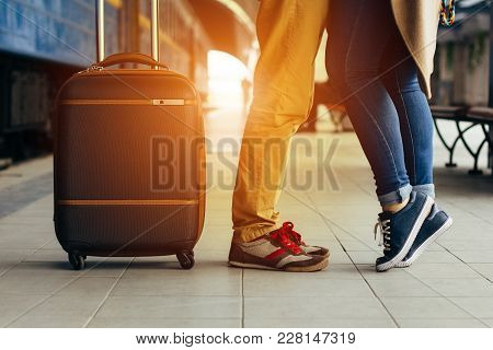 Legs Loving Couple Happy Hugging In The Train Station Of A Country After Arrival In Summer With A Wa