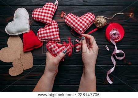 Valentine's Day. Creative Diy Craft Hobby. Making Handmade Craft Fabric Hearts And Decorating With R