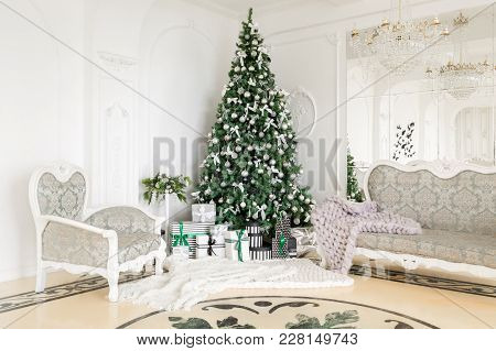 Christmas Morning. Classic Apartments With A White Fireplace, Decorated Tree, Bright Sofa, Large Win