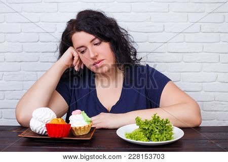 Young Upset Overweight Woman Bored Of Diets Choosing Between Healthy And Junk Food. Dieting, Healthy