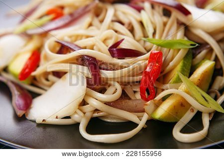 Udon Noodles With Pork And Peppers, Close Up. Japanese Cuisine