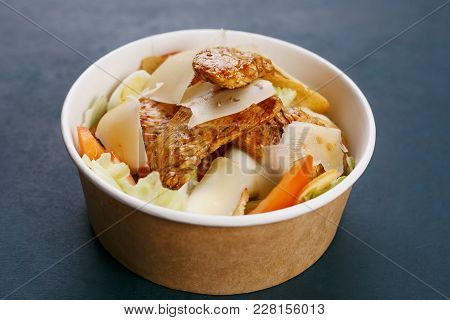 Teriyaki Chicken With Parmesan In A Paper Bowl. Korean Or Japanese Street Food Concept