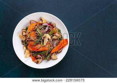 Delicious Fresh Pad Thai Noodles With Mushrooms And Vegetable Slices On Dark Background, Flat Lay Wi