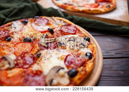 Delicious Freshly Baked Pizzas Close Up On The Wooden Board, Italian Food, Restaurant Concept