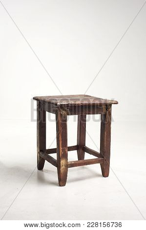 Wooden Old Stool On A White Background