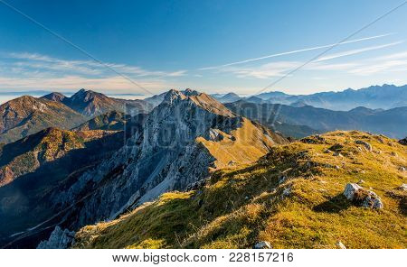 Panoramic View Of Spectacular Mountain Ridge. Slopes Of Kosuta In Autumn Colors, Slovenia.