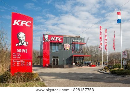Lelystad, The Netherlands - February 22, 2018: Car Park Near Dutch Motorway With Kfc Fastfood Restau