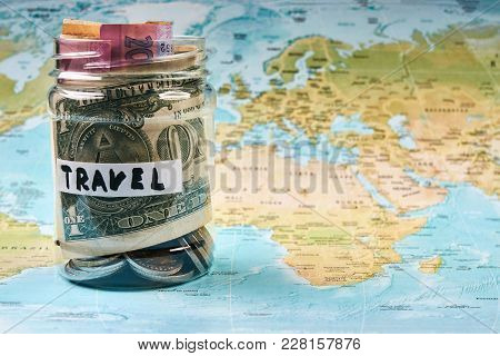 Travel Savings Money Concept. Collecting Money In Moneybox For Travel. Money Jar With Coins And Bank