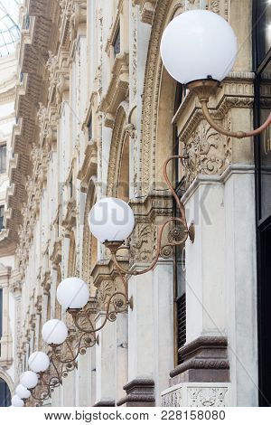 Vertical Perspective View Detail Of Row Classical Design City Lights With Round White Globes On Buil