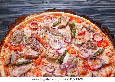 Pizza With Appetizing Crust, Food Background. Close Up Of Fresh Baked Pizza With Meat, Onions, Gherk