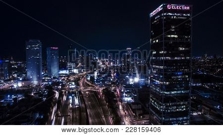 Tel Aviv, Israel - October 8, 2017: Night Aerial View Of Cars Drives On Highway Road, With Skyline A