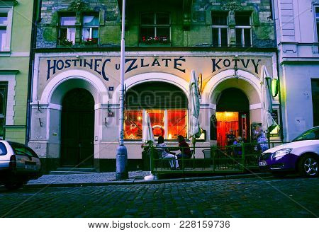 Prague Czech Republic - August 31 2017; Street At Night Outside Old Grungy  Restaurant With Interior