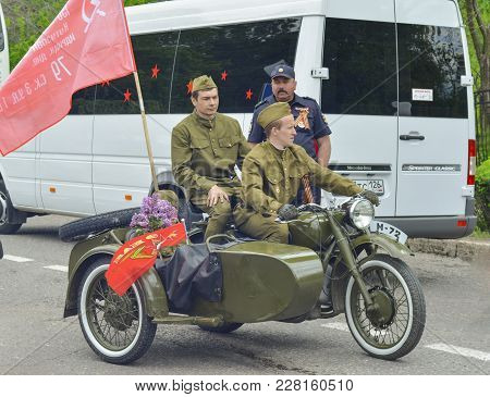 Pyatigorsk, Russia - May 09, 2017: Men In Uniform On A Motorcycle M-72 With A Cradle . The Victory D