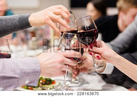 Clinking Glasses Of Wine. Cheers After Speech. Party At Cafe Or Restaurant. Family Celebration Or An
