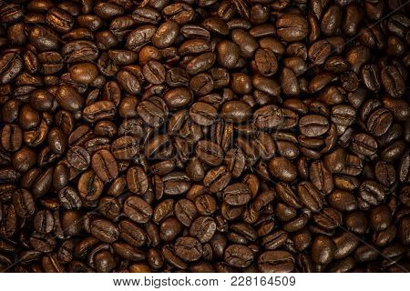 Frame Filled With Fresh Coffee Beans With A Warm Glow