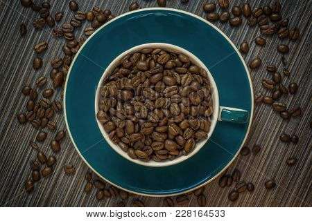 Coffee Cup Filled With Fresch Coffee Beans